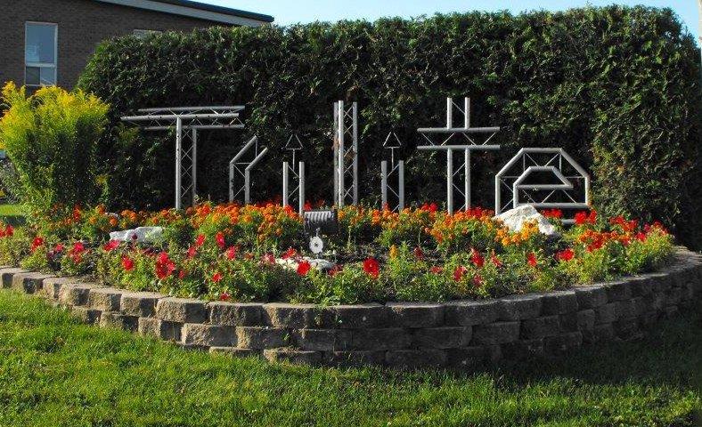 trilite logo garden - About Us